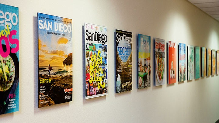 Images of San Diego Magazine covers hang on the wall in this undated photo.