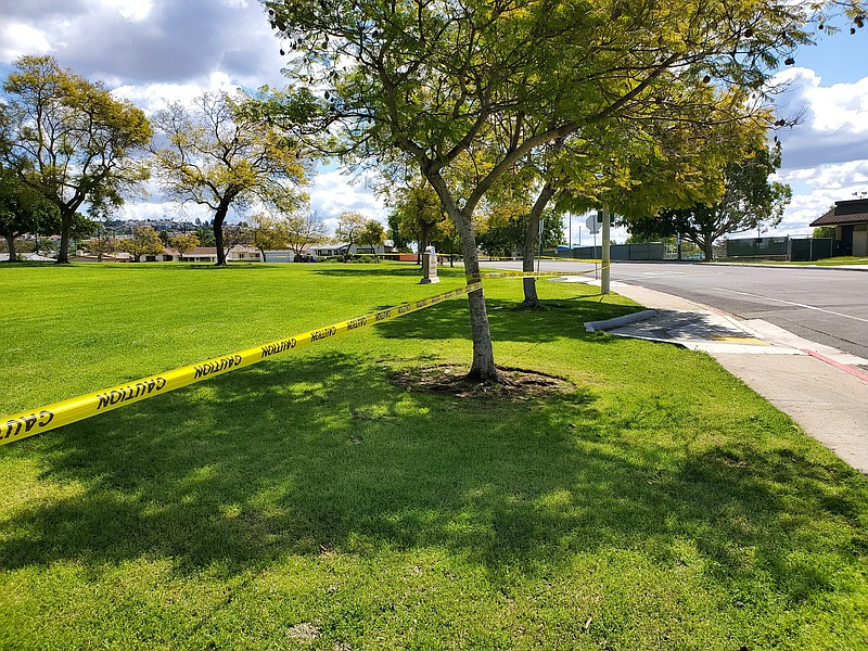 A park in Allied Gardens is taped off by police due to the closure of all San...