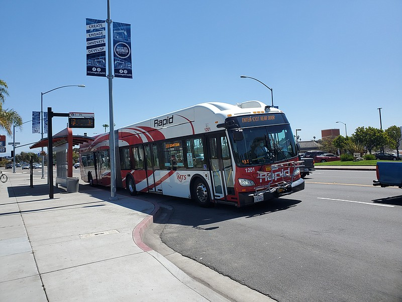 A bus pulls up to a stop on El Cajon Boulevard, April 16, 2020.