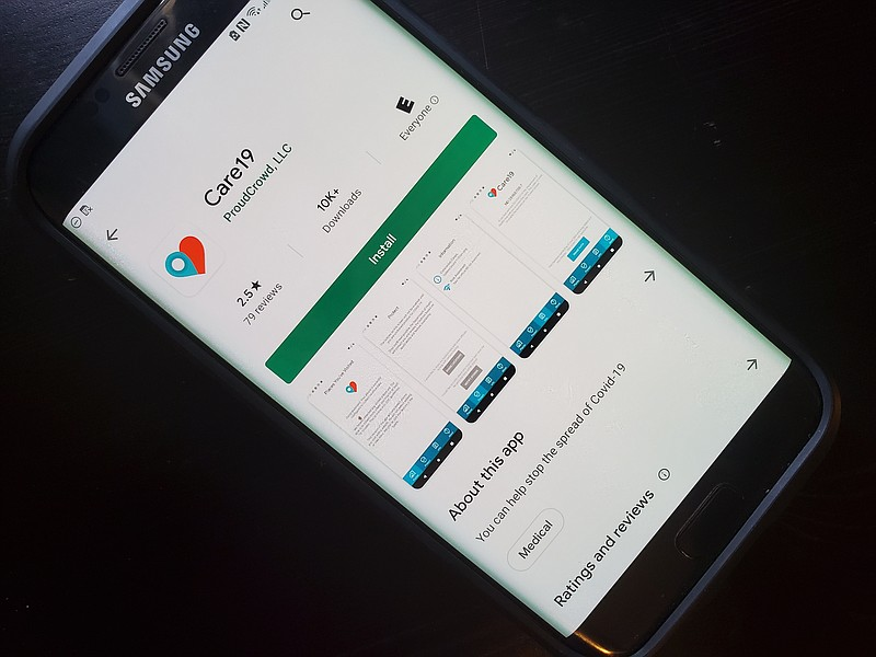 A phone displays Care19, the contact tracing app created by the North Dakota ...