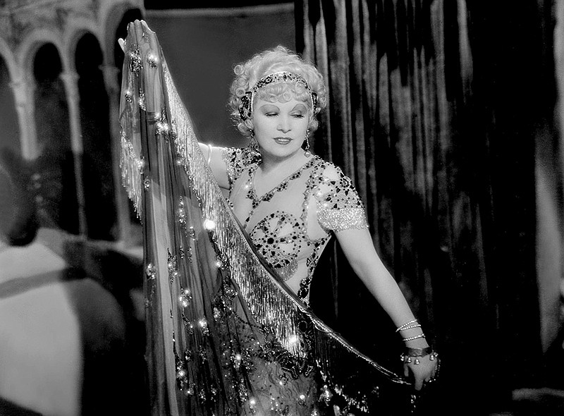 Mae West as Tira does a