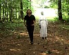 Filmmaker Frances Causey walking with a ghost-l...