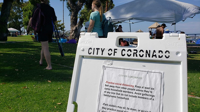 A sign enforcing social distancing at a park in Coronado, July 17, 2020