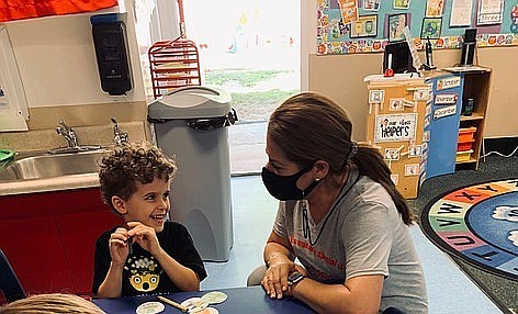 Holly Weber talks to a student at Magic Hours Preschool in this undated photo.