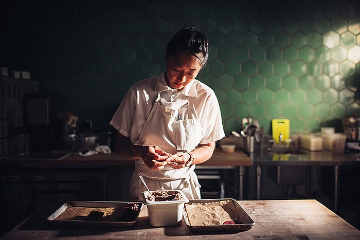 """Melissa Chou, pastry chef of Mister Jiu's at work in the """"Mister Jiu's Chinat..."""