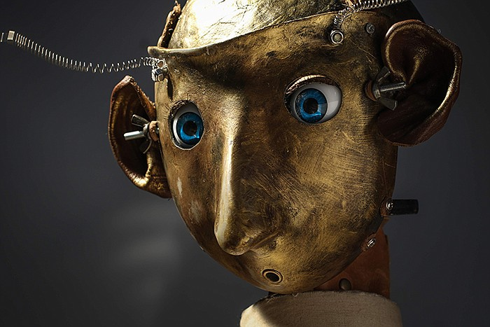 Close-up of puppet. When artist Maleonn realizes that his father is suffering...