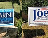 Yard signs for City Council candidates Marni Vo...