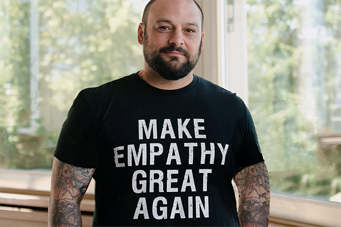 Christian Picciolini with t-shirt that reads