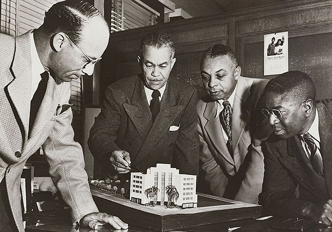 Paul Revere Williams (center) consults with Edgar J. Johnson, Norman O. Houst...