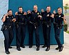 San Diego police officers pose for a photo on N...