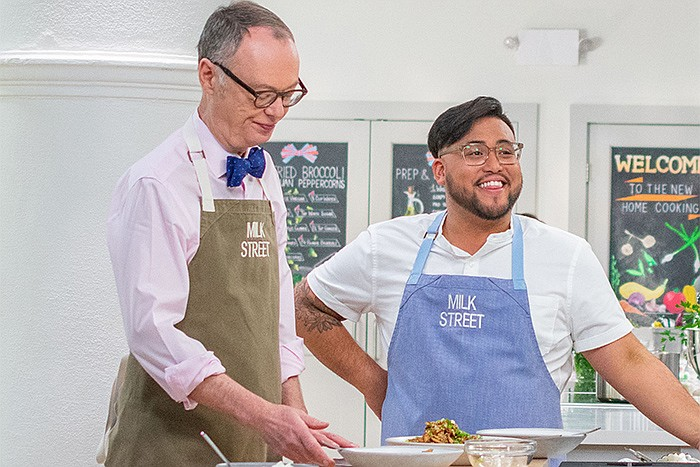 A behind-the-scenes photo of Host Christopher Kimball and Milk Street Cook Jo...