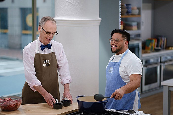 Milk Street Cook Josh Mamaclay (right) shows Christopher Kimball (left) the s...