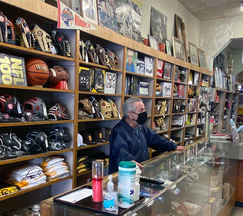 Gregg Schloss stands behind the counter on the last day A&B Sporting Goods in...