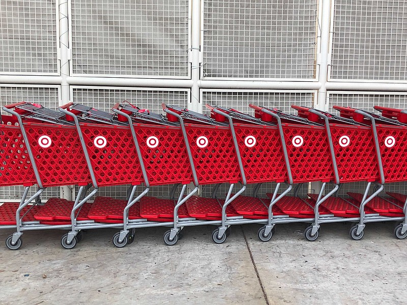 A line of grocery carts are shown parked in front of a San Diego Target store...