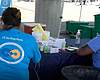 UCSD volunteers administer COVID-19 vaccines at...