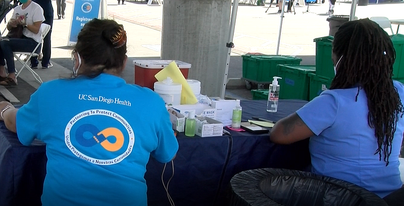 UCSD volunteers administer COVID-19 vaccines at the Jackie Robinson Family YM...