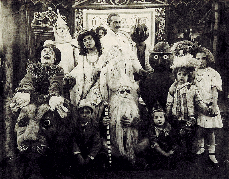 L. Frank Baum (center) surrounded by characters from The Fairylogue and Radio...