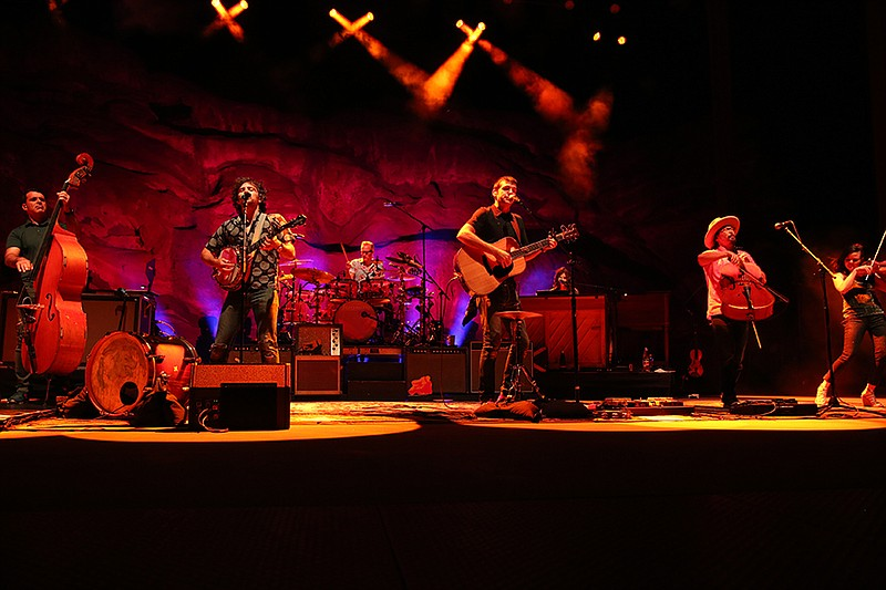 The Avett Brothers performing in the stunning natural setting of Colorado's R...