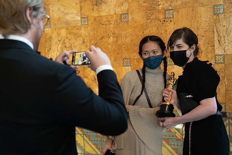 Chloé Zhao poses backstage with the Oscar® for Directing during the live ABC ...