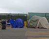 Homeless tents are shown lined up downtown Dieg...