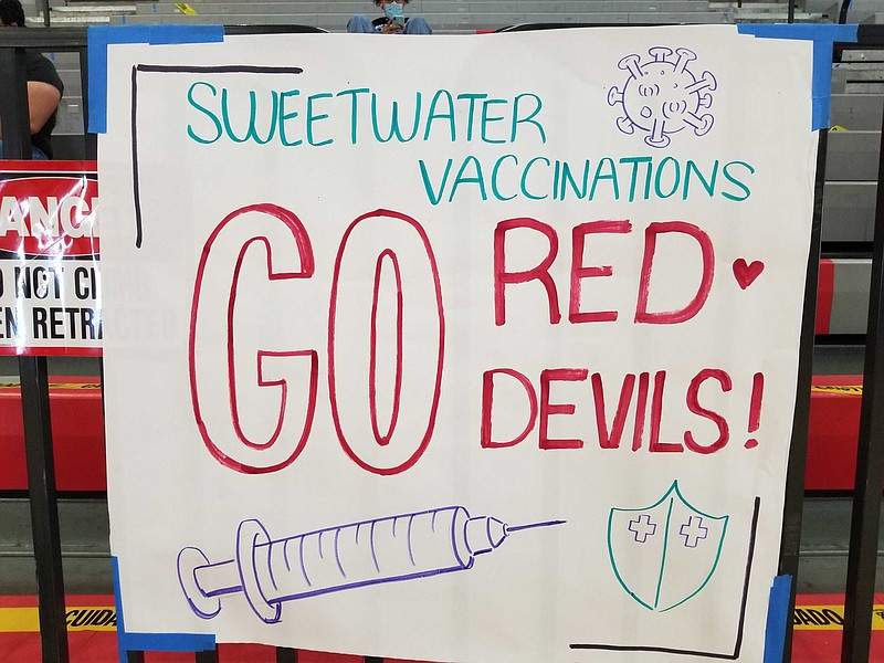 Vaccination sign hanging at Sweetwater High School for youth vaccination clin...