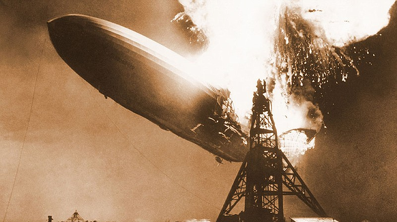 The German passenger airship Hindenburg seconds after catching fire, May 6, 1...