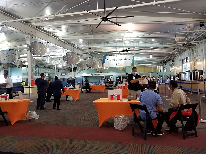 Holland America Line crew members get COVID-19 vaccine at the B Street Pier &...