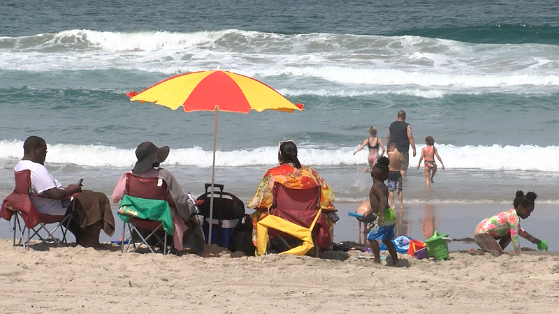Family of five enjoying Mission Beach without any pandemic restrictions on Ju...