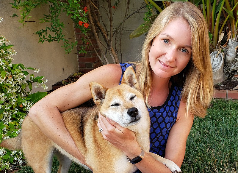 KPBS reporter Claire Trageser with her dog Kima, June 14, 2021.