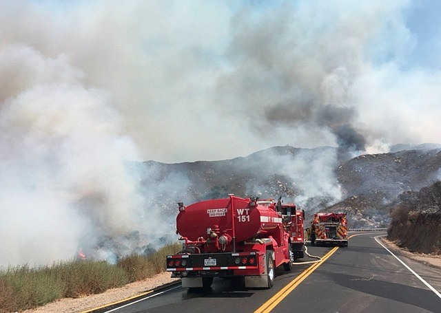 Cal Fire vehicles working on containing the Clevenger Fire on Sunday June 20,...