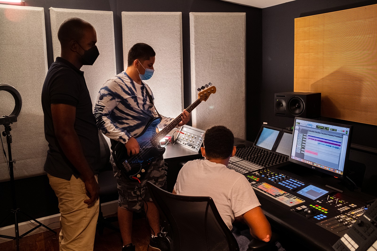 David's Harp Foundation founder Brandon Steppe oversees two students recordin...