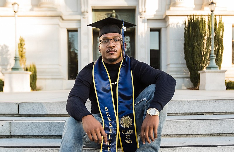 Aaron Harvey poses on the UC Berkeley campus after his graduation in this und...