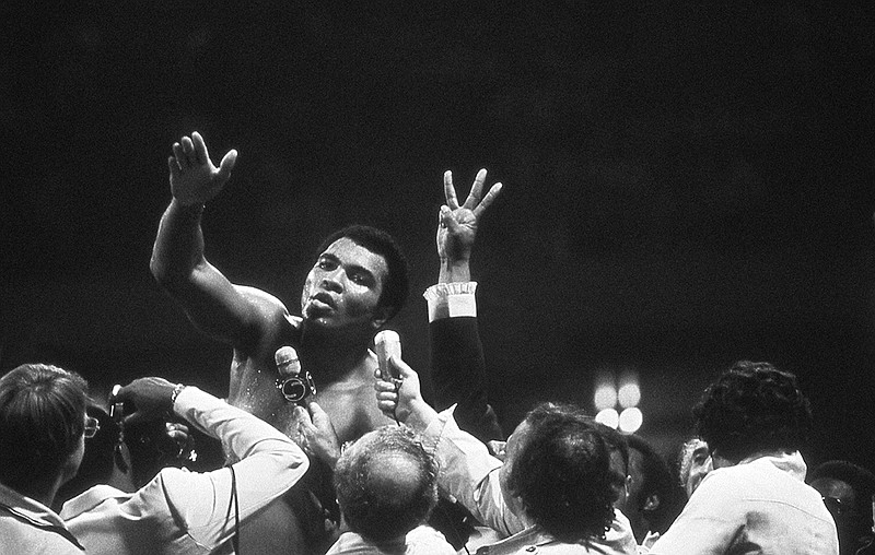 Muhammad Ali talks with the press after winning back the Heavyweight Champion...