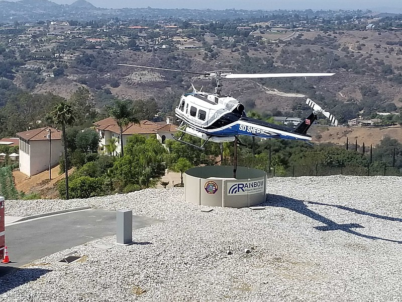 San Diego Sheriff helicopter hovers over the 'heli-hydrant' as its hose sucks...