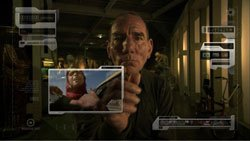Oscar nominated actor Pete Postlethwaite interacting with the futuristic interface designed specifically for the film by designer Taiyo Nagano. Credit: Spanner Films