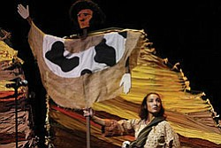 "Photo of an actress on stage in costume during a performance of ""Fire and Mist: Stories of Old Town."""