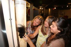 Three girls check out magnetic clouds at the Reuben H. Fleet Science Center.