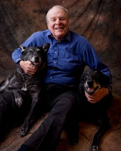 Popular writer and broadcaster Richard Lederer sitting with his dogs.