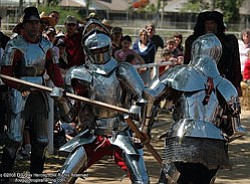 Photo of armored knights jousting by Douglas Herring.