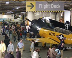 Photo of busy USS Midway hangar deck. Courtesy of USS Mid...