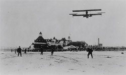 Glenn Curtiss flying over the Hotel del Coronado. Photograph from the collection at the Coronado Museum of History & Art.