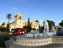 Photo of the historic House of Hospitality, the North Fountain, and Balboa Park's free red tram. Photo by Joanne DiBona