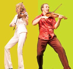 Promotional photo of Natalie MacMaster and Donnell Leahy (pictured playing the fiddle), two of the world's most celebrated Celtic fiddlers and the power couple of the Canadian fiddling world.