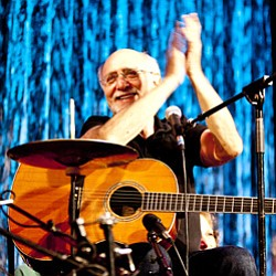 "Promotional photo of Pete Yarrow performing on stage during ""The Peter Yarrow Sing-Along Special."" Courtesy of Augusta Quirk"