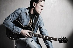 Promotional photo of Joe Bonamassa with his guitar. Photo courtesy of Karen Rosetzky
