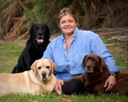 Photo of Cathy Mayer with her dogs