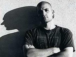 Black & white photo of multiple award-winning author China Miéville. He will make a special appearance on Sunday, July 25, 2010 at 2 p.m. on the 3rd floor auditorium of the Central Library, located at 820 E Street in downtown San Diego.