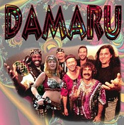 Photo of the musicians and dancers in Damaru. Damaru is a world beat music group from San Diego, California that incorporates African and middle-eastern rhythms into an incredibly energetic and danceable groove.