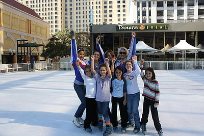 Image of visitors enjoying the Fantasy on Ice rink in Horton Square on a sunny day in San Diego.