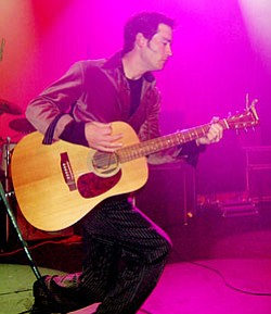 Local singer-songwriter Michael Tiernan performing on stage.